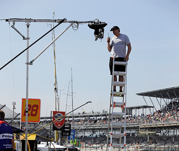 A technician checks on one the dozens of television cameras used for during the broadcast of the Indianapolis 500 IndyCar auto race at Indianapolis Motor Speedway, Friday, May 26, 2017 in Indianapolis. (AP Photo/Darron Cummings)