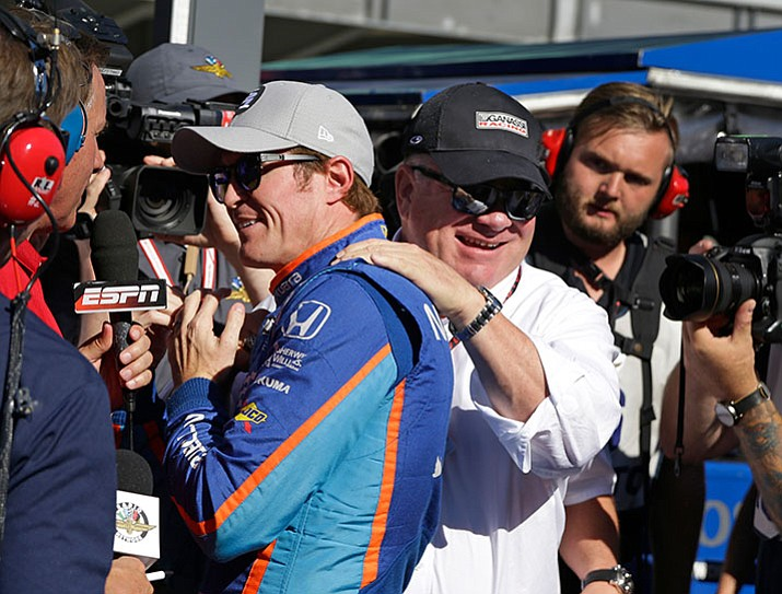 Car owner Chip Ganassi congratulates driver Scott Dixon, of New Zealand, after he won the pole during qualifications for the Indianapolis 500 IndyCar auto race at Indianapolis Motor Speedway, Sunday, May 21, in Indianapolis. (Michael Conroy/AP)