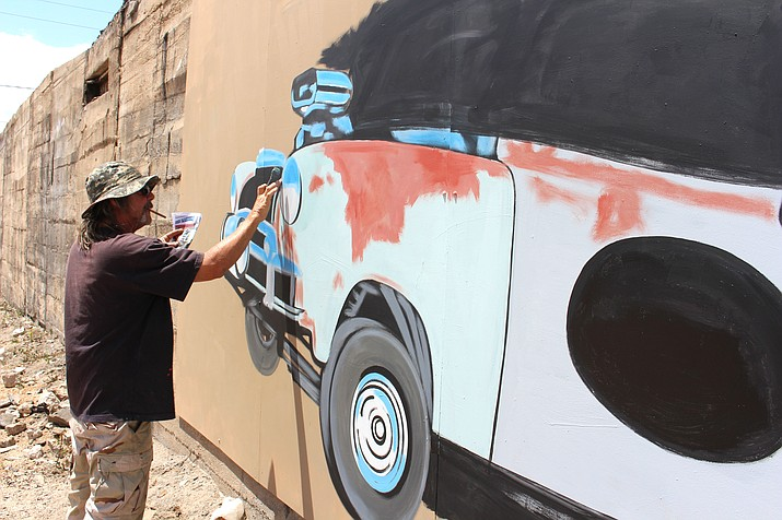 Dan, who doesn't disclose his last name, works on a mural for Rickety Cricket Brewing in downtown Kingman.