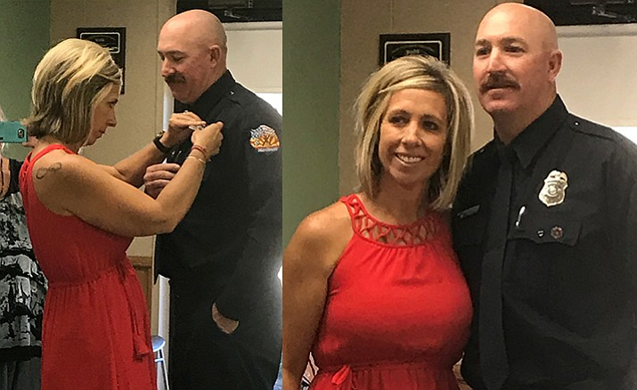 Spencer Young's wife, Jodi, had the honor of pinning on Young's new badge during his promotion ceremony May 23. (Photo courtesy VVFD)