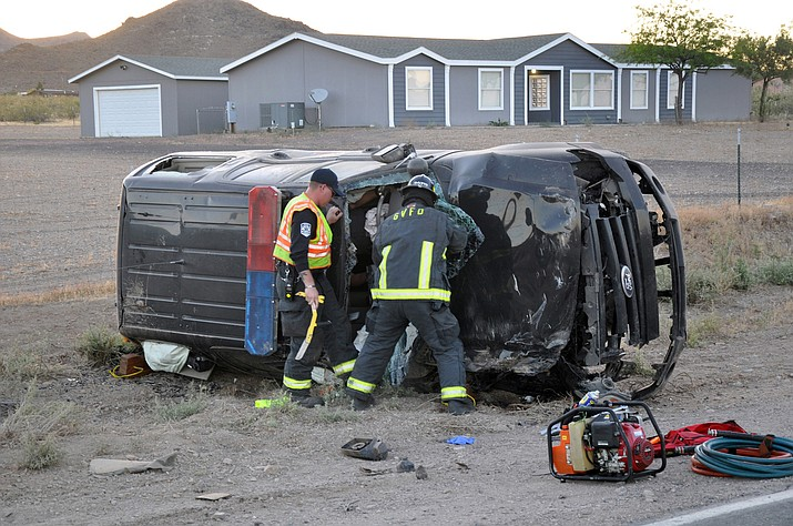 GVFD Firefighter-Engineer Jimmy Childers (left) and Firefighter-EMT Hunter Davis work on removing the windshield of the wrecked MCSO patrol unit in order to gain access to the trapped and injured deputy.