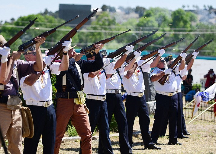 Members of the American Legion Post 6 Honor Guard and Arizona Rough Riders Troop 1-A fire a rifle salute during the annual Memorial Day program at the Citizens Cemetery Monday, May 29 in Prescott. (Les Stukenberg/Courier)