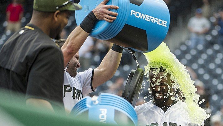 Pittsburgh Pirates' Andrew McCutchen gets doused with an energy drink by teammate Francisco Cervelli after hitting a walk-off home run off Arizona Diamondbacks relief pitcher Archie Bradley in Pittsburgh on Monday, May 29. Pittsburgh won 4-3.