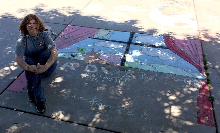 "Seventh-grader Mackenzie Shumate of Heritage Middle School said she really gets into art. She is shown here working on her Chalk It Up piece on May 22 that she titled ""Adventure Time."" This was the fourth annual event that corresponds with honoring the late Kalen Earle, a Chino Valley High School student."