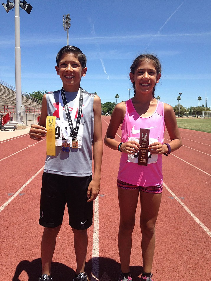 Wyatt Pickering, left, and sister, Savannah, pose after the USA Track and Field State Championships May 20-21.