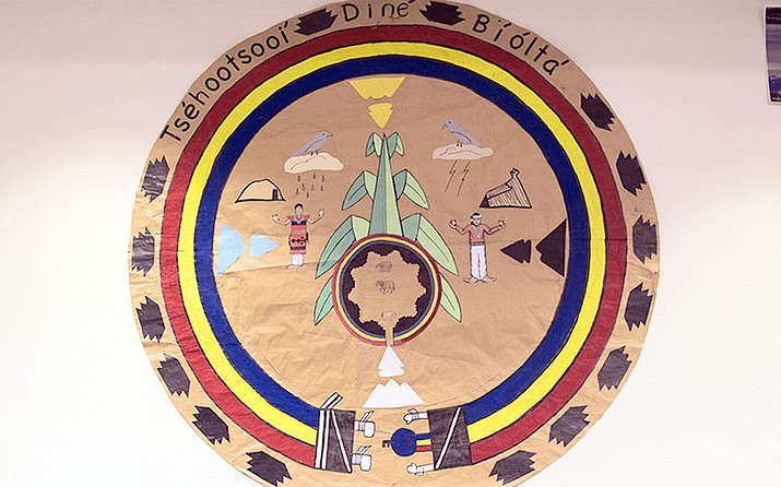 A seal of Diné Bi' Olta' created by students is displayed in the school's library in Window Rock. The K-6 immersion school incorporates the Navajo language and culture into its curriculum. Photo/Taylor Notah, Cronkite News