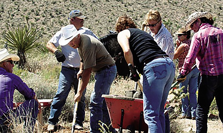 Members of the Kingman Back Country Horsemen mix cement that was used to install benches along the Dolan Springs Trail System in 2015.