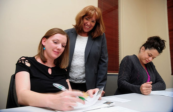 Prescott City Clerk Dana DeLong watches Michelle Rush and Darla Eastman count signatures on petitions as employees for the City of Prescott start the process of verifying signatures for Mayor and City Council candidates Wednesday, May 31. (Les Stukenberg/Courier)