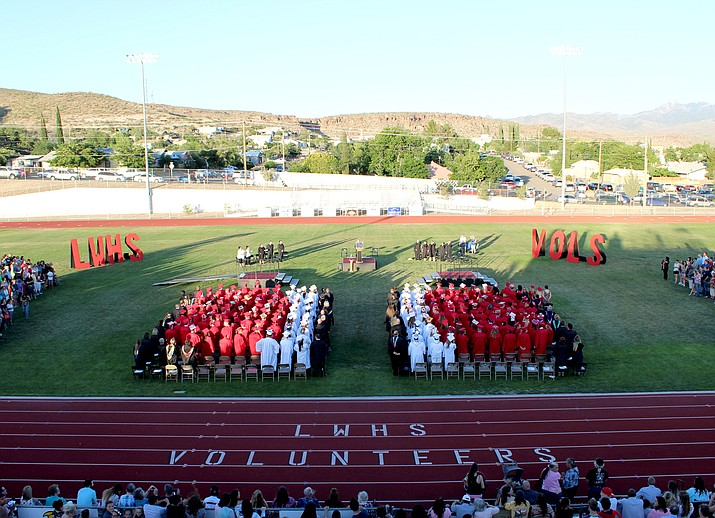 A new tradition for LWHS. The top honor students – in white gowns – form the number 11 in the middle of the graduates. Eleven represents the Kingman firefighters, mostly volunteers for whom the school is named after, who died in the 1973 Doxol Explosion.
