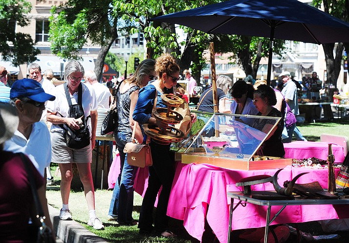 Shoppers look through some of the antiques that about 40 vendors brought to the Yavapai County Courthouse Plaza in 2015. The 2017 event is set for Sunday, June 4.