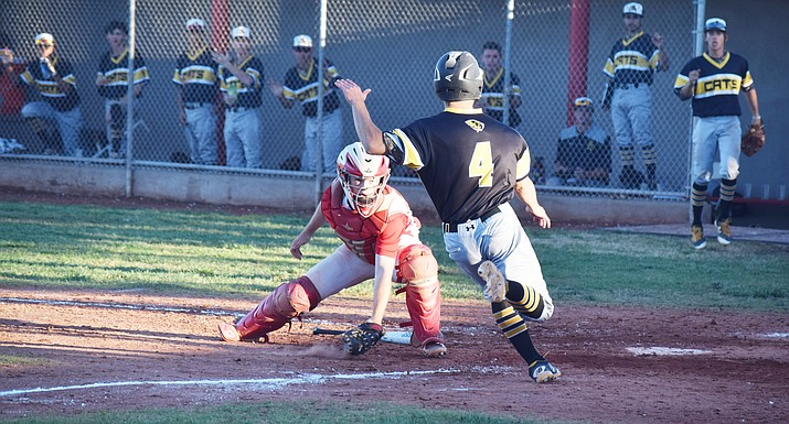 Mingus Union senior catcher Gus Henley prepares to tag out a base runner. Henley was named to the 4A North Arizona Baseball Coaches Association all-star team and  first team All- Region after hitting .405 this season. (VVN/James Kelley)