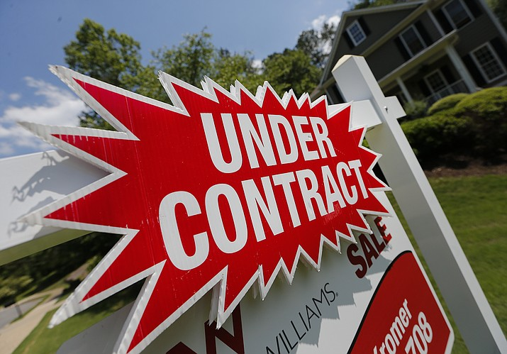 In this Tuesday, May 16, 2017, photo, a sign advertises that an existing home for sale is under contract in Roswell, Ga. Saving up for a down payment is the biggest hurdle for many would-be homebuyers, particularly those looking to make the leap from renting to owning. (AP Photo/John Bazemore)