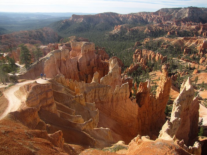 Morning light on the salmon-pink formations of Bryce Canyon. Note the hikers on the left for scale.