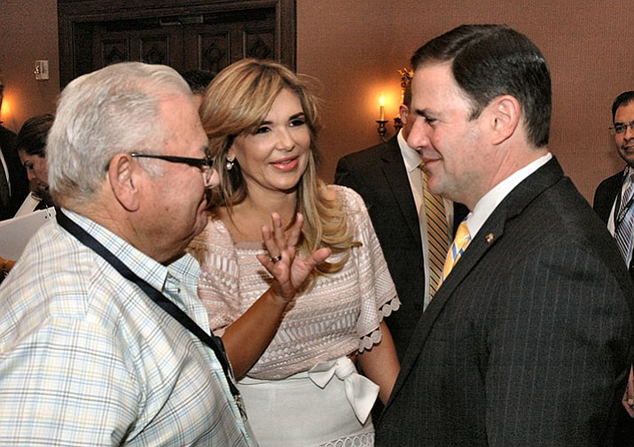 Sonora Gov. Claudia Pavlovich chats Friday with Arizona Gov. Doug Ducey at the annual Arizona-Mexico Summit. With them is Sergio Torres, Pavlovich's father-in-law. (Howard Fischer, Capitol Media Services)