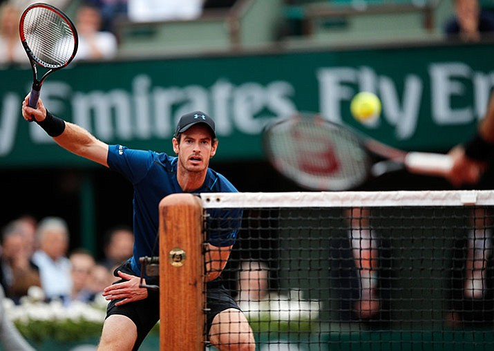 Britain's Andy Murray, left, eyes the ball as Argentina's Juan Martin del Potro volleys during their third round match of the French Open, Saturday, June 3, in Paris. Murray won 7-6, 7-5, 6-0. (Christophe Ena/AP)