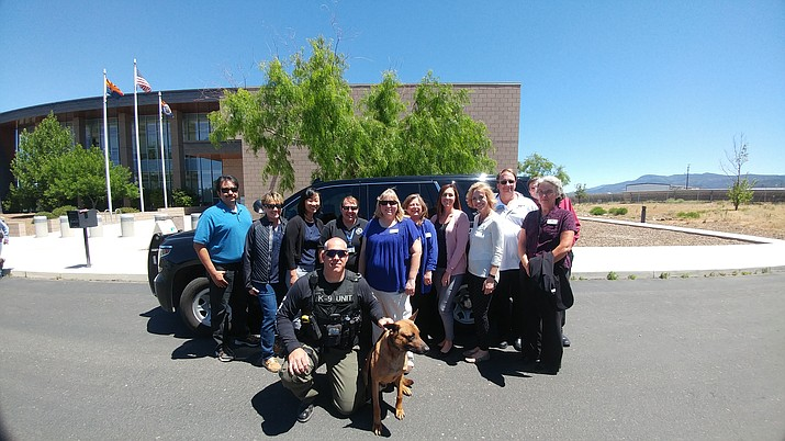"From left, Art Durazo, Jill Clark, Sebra Choe, Monica Kuhlt, Debbie Breitkreutz, Kathy Wombacher, Stephanie Vocca, Tammy Yoakum, Mike Spitz, Marlayne Hatler. Behind: Bob Ingulli. Front: Deputy Jeff Bowers with Canine Officer ""Claymore."" Photo credit: Steve McClure"