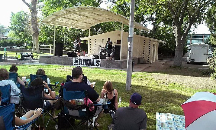 Kingman residents enjoy a concert performance at Metcalfe Park presented by Sounds of Kingman, a nonprofit cultural organization founded in 2010.