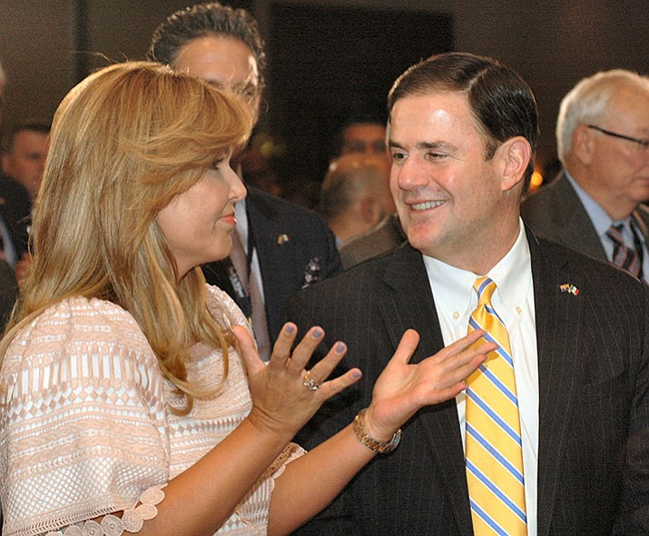 Sonoran Governor Claudia Paviovich and Arizona Governor Doug Ducey chat during a Arizona-Mexico Commission meeting Friday in Prescott Valley. (Howard Fischer/Capitol Media Services)
