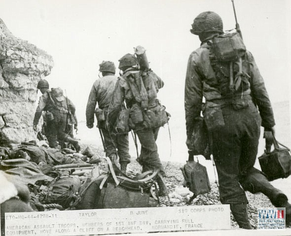 Photos from the invasion of Normandy include infantry men scrambling for position and an overall shot of allied landing craft on the Normandy beach on June 6, 1944. D-Day was the beginning of the end of World War II.