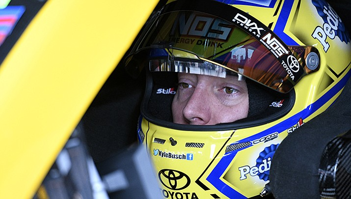 Kyle Busch sits in his car before final practice for the NASCAR Cup series auto race, Saturday, June 3, at Dover International Speedway in Dover, Del.