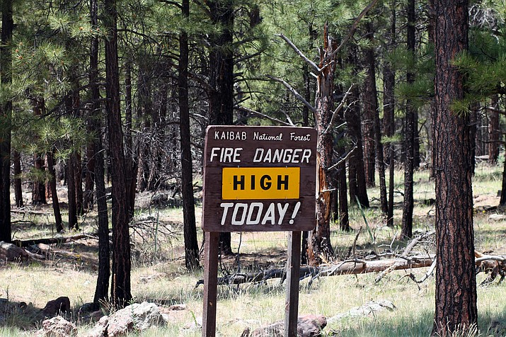Signs like this one located through the Kaibab National Forest alert visitors to the prevailing fire danger of the day.