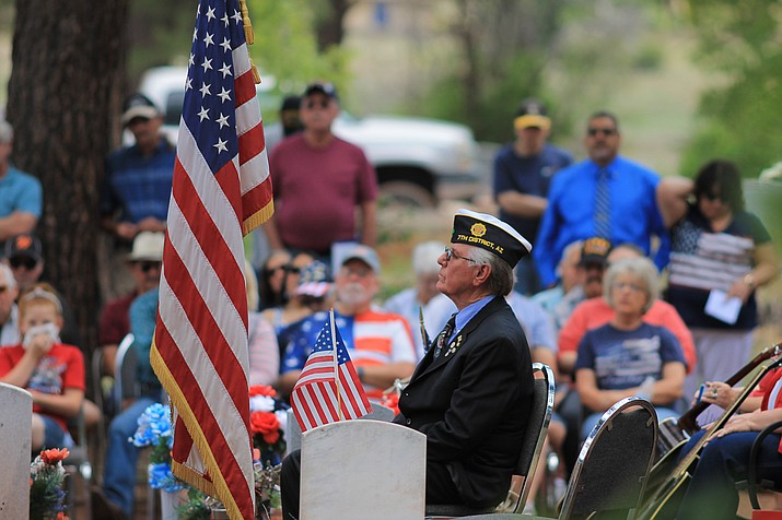 Veteran Rodger Ely listens to Charlie Bassett speak at the Williams Memorial Day service at the Williams Cemetery May 29.