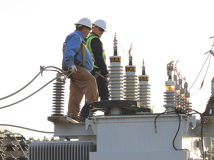 APS employees work to restore power after a squirrel damaged a transformer in March 2017. APS is working with the city of Williams to upgrade the city's electric system.