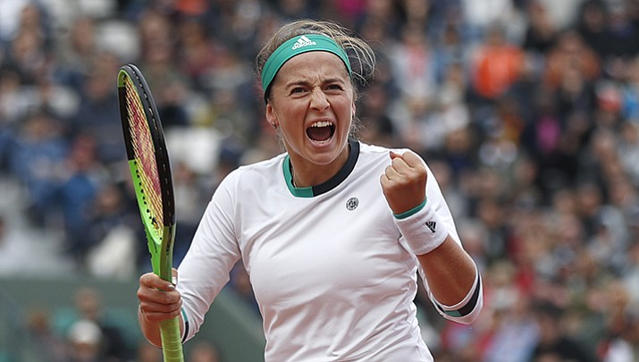 Jelena Ostapenko clenches her fist after scoring a point against Caroline Wozniacki during their quarterfinal match of the French Open tennis tournament at the Roland Garros stadium Tuesday, June 6.