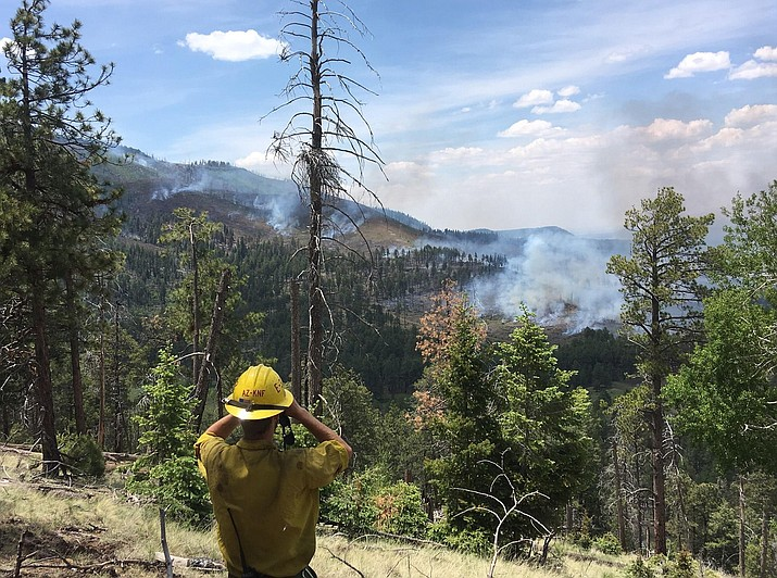 Kaibab National Forest firefighters respond to a lightning caused fire on Kendrick Peak.