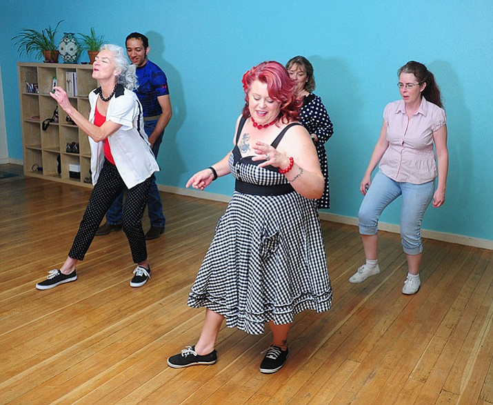 Instructor Monique McConnell goes through a dance step with Beth Brehio, Phillip Eby, Laurie Allen and Jenn Luebke at a Lindy Hop class at the Flying Nest Studio in downtown Prescott Tuesday, June 7. (Les Stukenberg/Courier)