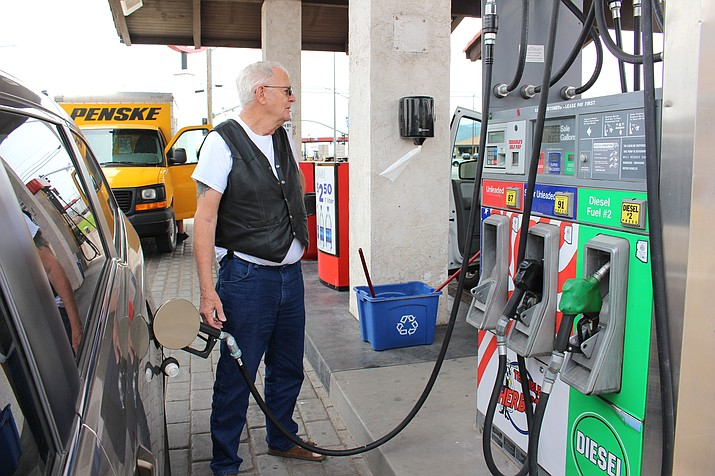 Lewis Wicoff, of Eutawville, South Carolina, fills up at Terrible Herbst on Andy Devine Avenue, paying $2.40 a gallon for regular unleaded with a credit card. He said Arizona was among the more expensive states for gasoline. The national average is $2.35.