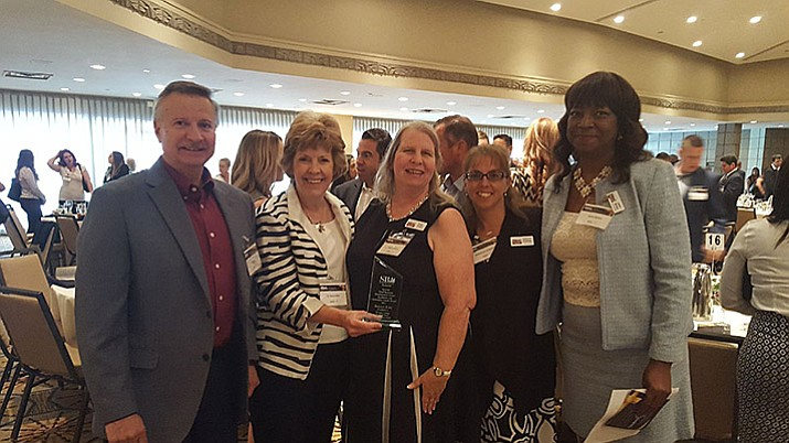 From left, Al Carlow, Yavapai College SBDC Business Analyst (retired); Dr. Penny Wills, YC President; Kathryn Bazan, YC SBDC Business Analyst; Katherine Anderson, YC SBDC Program Assistant; Janice Barham, Associate State Director AZSBDC Network. (Courtesy)