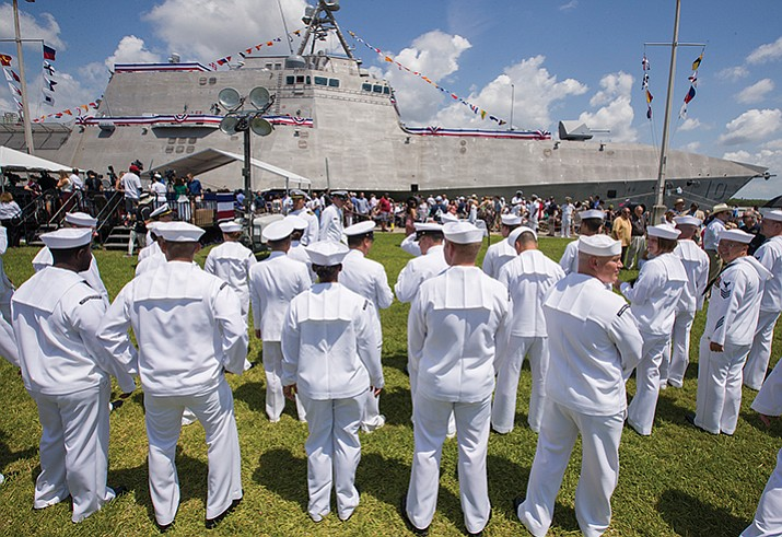 "U.S. Navy Sailors wait before a commissioning ceremony for the USS Gabrielle Giffords in Galveston, Texas on Saturday, June 10, 2017. The new warship named after Giffords who was wounded during a deadly 2011 shooting, has been put into active service following the ceremony. Giffords told a crowd at the ceremony she was honored the ship will carry her name and the vessel is ""strong and tough, just like her crew."" (Stuart Villanueva /The Galveston County Daily News via AP)"