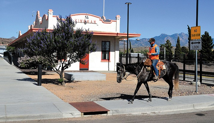 Romberger and Gus reach the end of their (current) Arizona ride at the Kingman Railroad Depot.