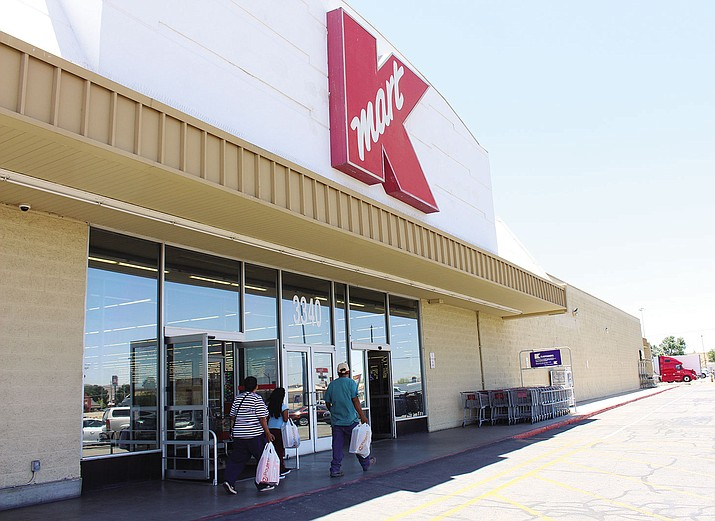 Shoppers enter the Kingman Kmart store at 3340 Andy Devine Ave., which has been spared from the latest list of 66 store closings nationwide. Other Kmart stores in Bullhead City, Nogales, Henderson and Las Vegas, and Blythe, California, are the on closure list.