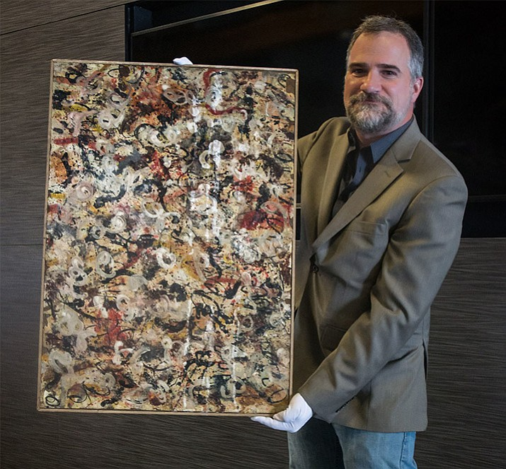 Auctioneer Josh Levine, owner and CEO of J. Levine Auction & Appraisal, holds a lost Jackson Pollock gouache painting that will be auctioned on June 20 in Scottsdale, Arizona. (Sami Gill, PRNewsfoto/J. Levine Auction & Appraisal)