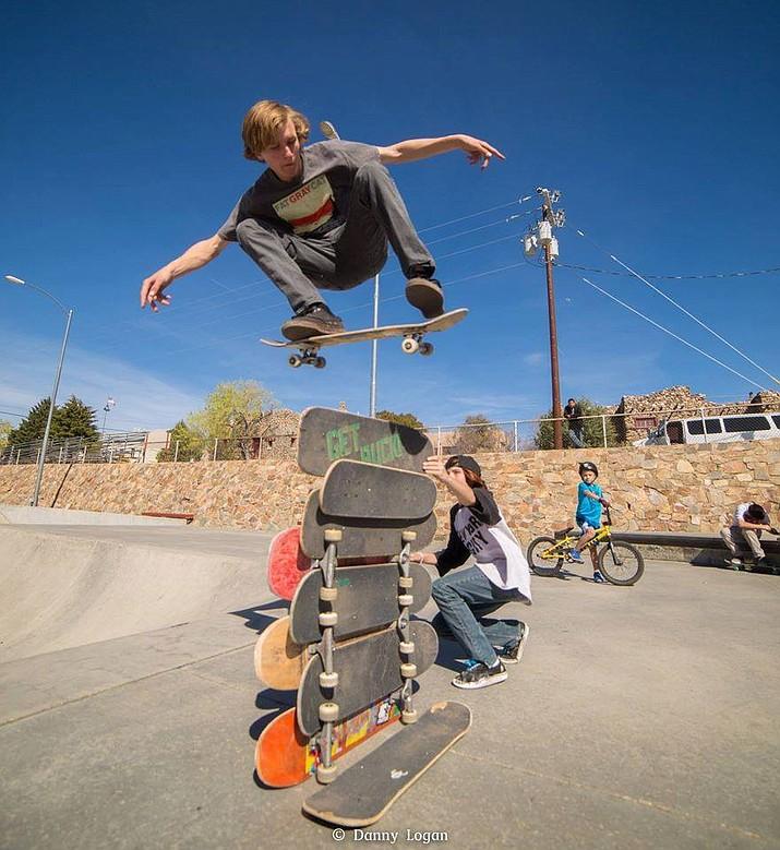 Kelty McCabe flies over stacked skateboards at the Mike Fann Community Skate Park in Prescott.