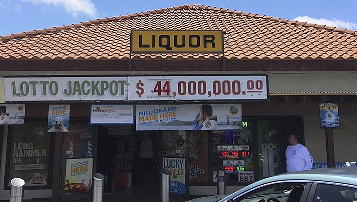 A sole winning Powerball ticket worth $447.8 million and matching all six numbers was sold at Marietta Liquors & Deli in Menifee, Califorbia and will claim the 10th largest lottery prize in U.S. history. (Fadi Alberre via AP)