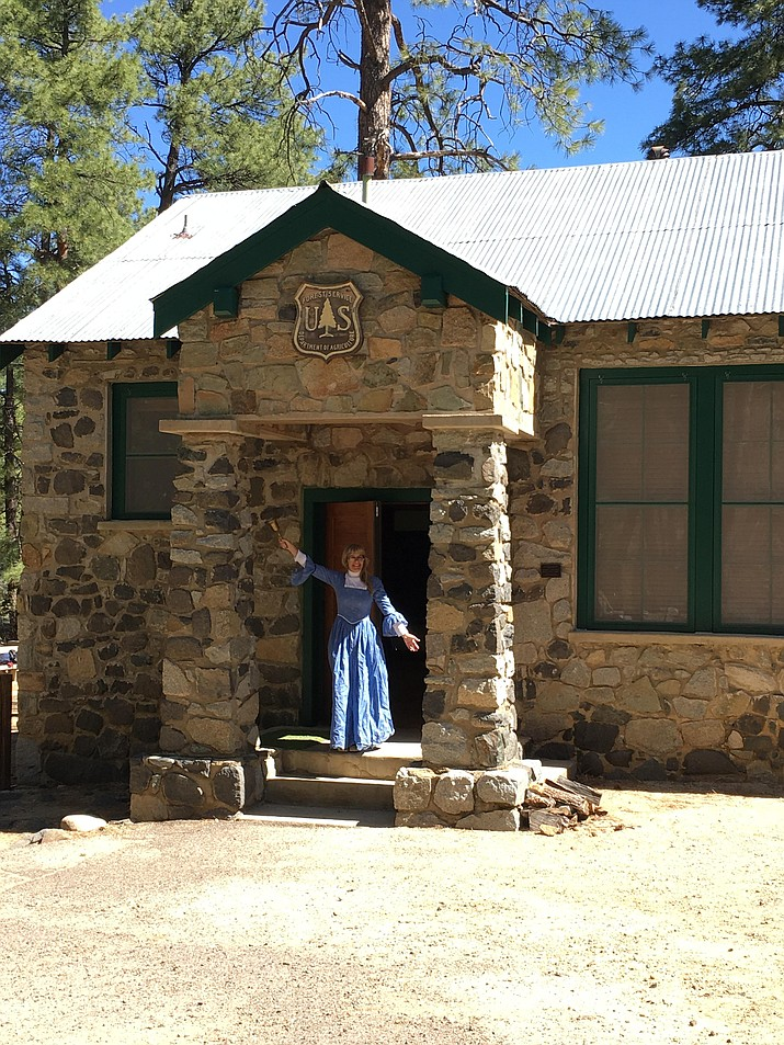 Karen Oliver Sampson, Miss Oliver, rings the 1937 school bell at the Groom Creek Schoolhouse.