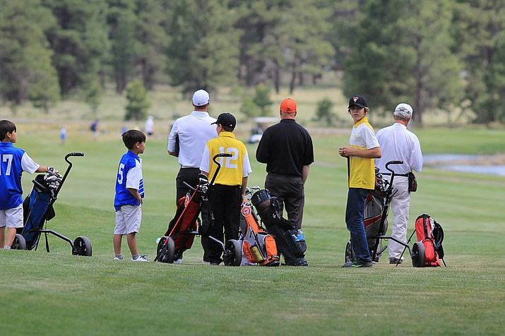 The Elephant Rocks junior golfers prepare at the start of a match with Flagstaff June 7.