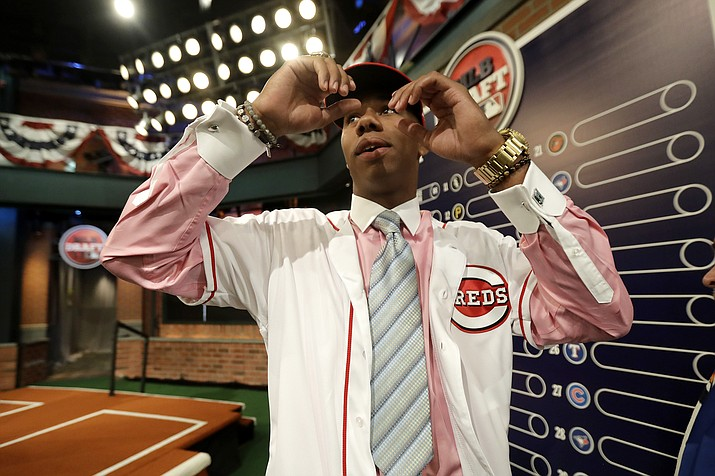 Hunter Greene, a pitcher and shortstop from Notre Dame High School in Sherman Oaks, Calif., walks off the stage after being selected No. 2 by the Cincinnati Reds in the first round of the Major League Baseball draft, Monday, June 12, 2017, in Secaucus, N.J. (Julio Cortez/AP)