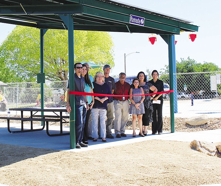 Officials for the City of Kingman, UniSource Energy Services and the Venture Club of Kingman officially cut the ribbon Tuesday to dedicate a solar ramada at the Splash Pad at Cecil Davis Park. The structure will power the Splash Pad pump and provide shade for a picnic area.