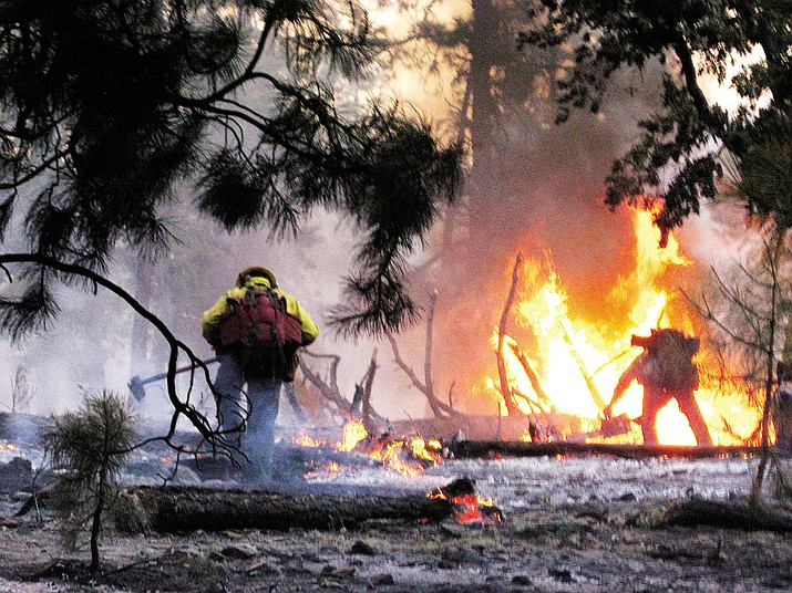 Dry conditions trigger fire restrictions in western Arizona. Here firefighters fight flames near Taylor in 2009.