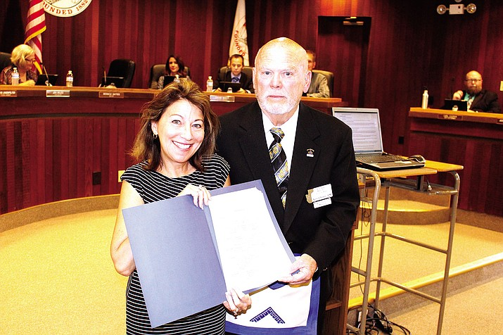 Mayor Monica Gates awards proclamation of Free and Accepted Masons Day to Ken Chism of Kingman's local Masonic lodge.