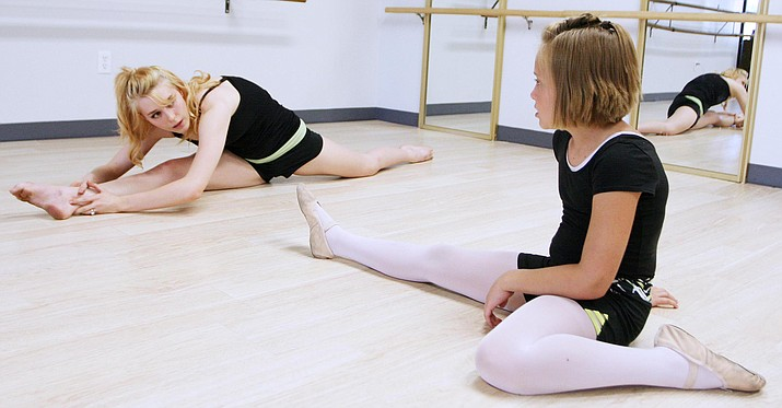 Alyssa Glass, owner of Major Motion Dance in Camp Verde, helps 9-year-old Jayde Moore with her dance lessons. (Photo by Bill Helm)