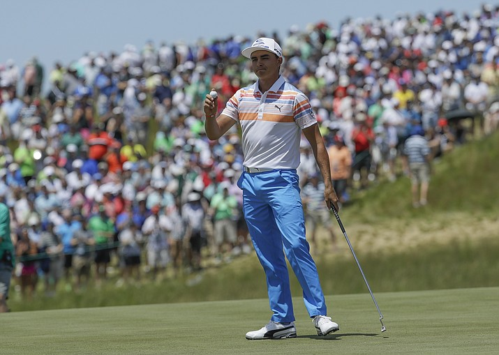 Rickie Fowler acknowledges the crowd after his first round of the U.S. Open on Thursday, June 15, 2017, at Erin Hills in Erin, Wis. (David J. Phillip/AP)