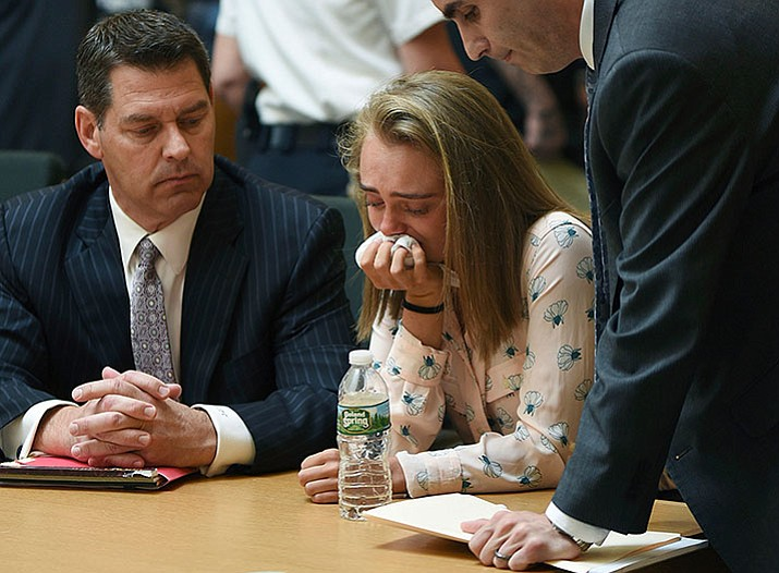 Michelle Carter cries while flanked by defense attorneys Joseph Cataldo, left, and Cory Madera, after being found guilty of involuntary manslaughter in the suicide of Conrad Roy III, Friday in Bristol Juvenile Court in Taunton, Mass. (Glenn C.Silva/Fairhaven Neighborhood News, Pool)