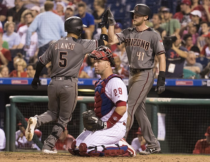 Arizona Diamondbacks' Gregor Blanco, left, celebrates his two-run home run with Jeremy Hazelbaker, right, as Philadelphia Phillies catcher Cameron Rupp, center, looks on during the seventh inning Friday, June 16, 2017, in Philadelphia. (Chris Szagola/AP)