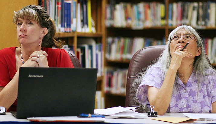"Camp Verde Unified School District's administrative assistant Mary Hudson, left, and board member Helen Freeman, listen as Superintendent Dr. Dennis Goodwin shares a draft of the district's strategic plan, which Dr. Goodwin refers to as a ""living, evolving document."" (Photo by Bill Helm)"