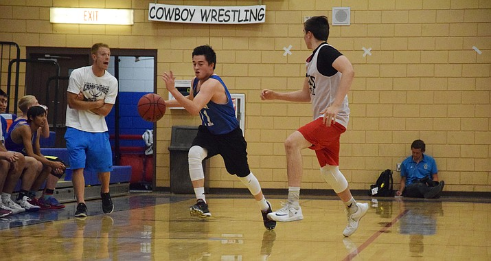 Camp Verde junior guard Ishmael Hogan takes the ball up the court on Friday night against Mingus Union at home. Cowboys' head coach Daniel Wall said Hogan has been a pleasant surprise this spring and summer. (VVN/James Kelley)